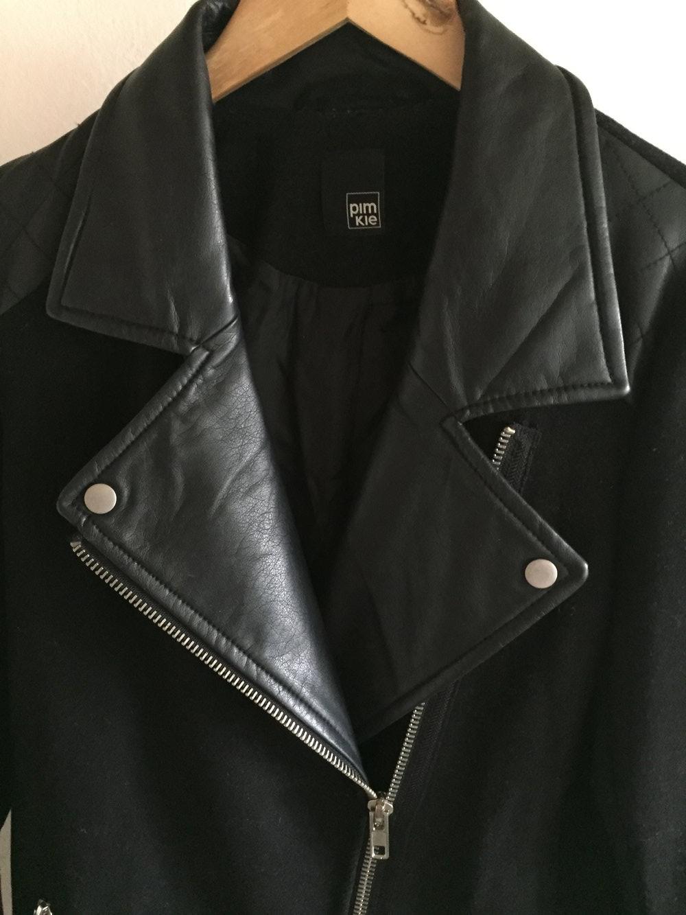 Pimkie schwarzer langer wintermantel for Schwarzer langer mantel
